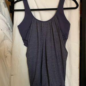Purple Lululemon workout shirt with sports bra